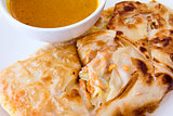 Indian Roti Prata with Curry Sauce Closeup