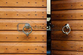 Old Wooden Door with Metal Knockers in Verona, Veneto, Italy