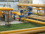 Natural gas station with yellow pipes power plant