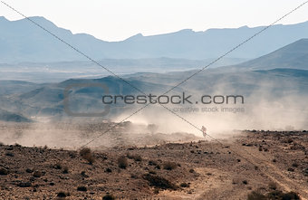 Bike crossing a stone desert.