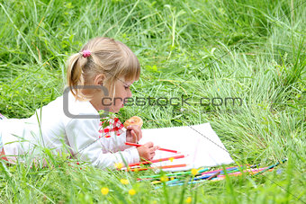 beautiful little girl on the nature