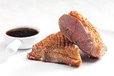 fried duck breast with sauce of honey, balsamico and red wine