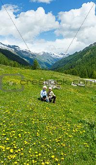 Children on summer mountain meadow (Alps, Switzerland)