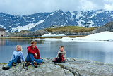Family near Alps mountain lake