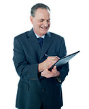 Elder confident man making business notes