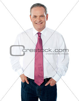 Casual senior businessman posing