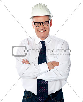 Portrait of happy senior foreman with hard hat