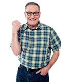 Excited elderly male dressed in casuals
