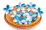 Paper flowers in a basket
