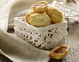 Cookies in the form of nuts in a white basket