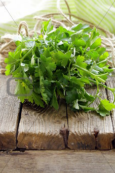 green, organic parsley on wooden table