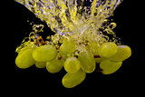 Grapes in water splash isolated on black background