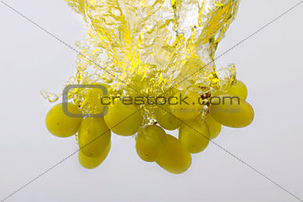 Grapes in water splash isolated on white background