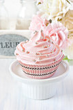 Pink cupcake.