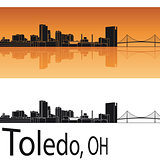 Toledo skyline in orange background
