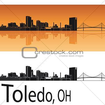 Toledo skyline in orange background