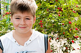 A boy of about rosehip with ripe fruits
