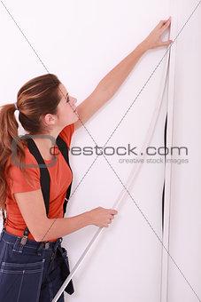 Woman concealing wiring