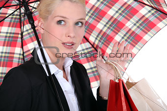 portrait of a woman under umbrella
