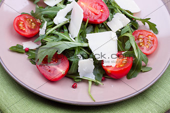 Close up salad with ruccola and tomatoes