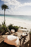 terrace of a cabana on beach with bean bag chair