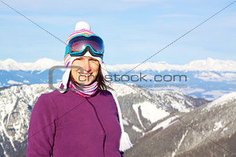 Smiling girl in snowy mountains