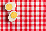 two halves of a boiled egg