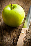 green apple with knife