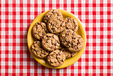 chocolate cookies on checkered tablecloth