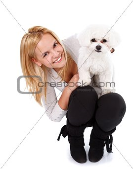 Adorable puppy and young girl