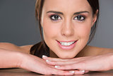 Excited Young Brunette Female Resting Head on Hands Headshot