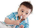 Indian baby brushing teeth