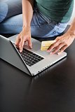 typing in laptop with credit card