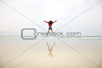 woman jumping on mist sky