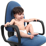 Baby sitting on an office chair