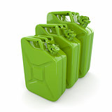 Three green canisters. Gasoline can on white background