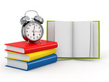 Time for school. Alarm clock on books