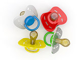Baby&#39;s pacifiers on white isolated background.