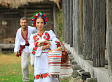 Young couple in Ukrainian style clothes