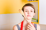 Copyspace portrait of a cooking girl with spoon