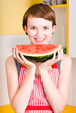 Smiling young woman eating fresh fruit watermelon