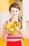 Beautiful woman with smile and fresh fruit bowl