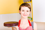 Woman cooking easter chocolate cake at home