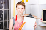 Woman pointing to healthy eating shopping list
