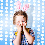 Adorable little kid wearing easter bunny ears