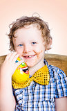 Smiling happy kid holding easter egg gift