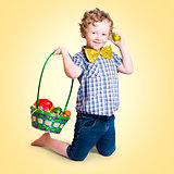 Sweet little child holding easter egg basket
