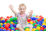Happy boy playing colorful balls isolated on white