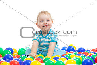 Cute boy playing colorful balls isolated on white