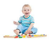 happy child playing educational toys on floor